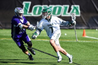 Loyola Sophomore Sensation Pat Spencer led the Greyhounds with record setting 10 point game over Holy Cross Crusaders.